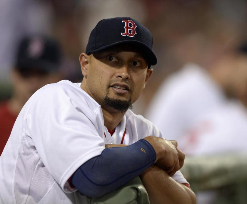 (Boston, MA, 07/29/14) Boston Red Sox right fielder Shane Victorino (18) peers out of the Red Sox dugout during the ninth inning of a Major League Baseball game against the Toronto Blue Jays at Fenway Park in Boston, Mass., on Tuesday, July 29, 2014. Staff photo by Christopher Evans